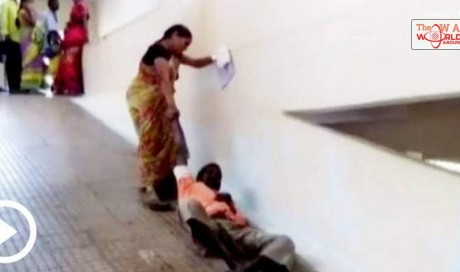 No stretcher, woman forced to drag husband on hospital ramp