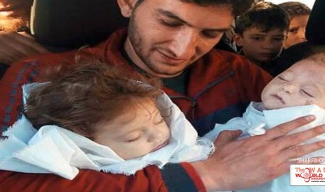 Grief-stricken father of twins buries 22 family members after Syria gas attack