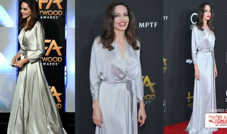 Angelina Jolie Shines in a Silver Dress and Red Lipstick at the Hollywood Film Awards