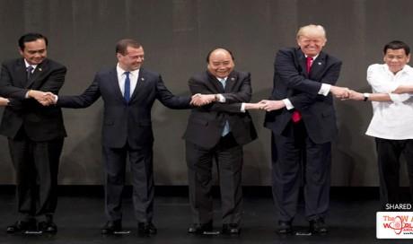 US President Donald Trump captured in awkward cross-body handshake at ASEAN summit