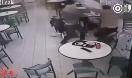 Video: Man beats customer with chair for complaining about noisy daughter