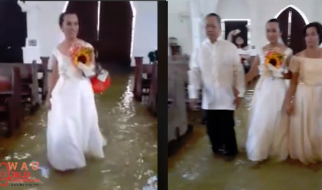 Filipino bride doesn't let a flooded church stop her wedding