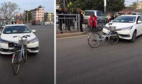 Car damaged by bicycle after collision in viral photo
