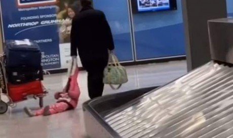 Video: Man drags daughter through airport by her hood