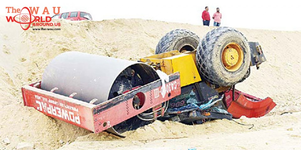 Asian dies in bulldozer flipover