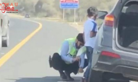 Video: UAE police officer goes viral for changing tyre of stranded SUV
