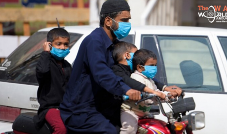 As virus explodes, world races to mask up